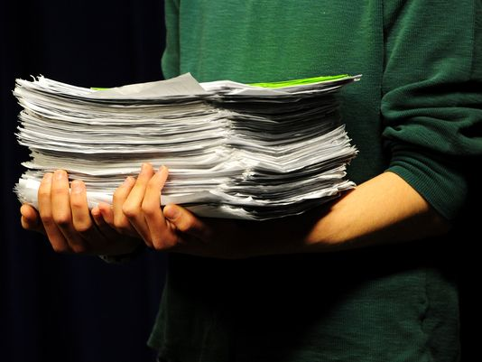 Jacob von Broth of H2Origami Project holds a stack of complaints against a water deal during a press conference May 14, 2015, at the Oregon State Capitol in Salem.(Photo: Brent Drinkut, (Salem, Ore.) Statesman Journal)